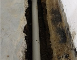Step 2 Excavate trench and install perforated pipe on top of drainage fabric