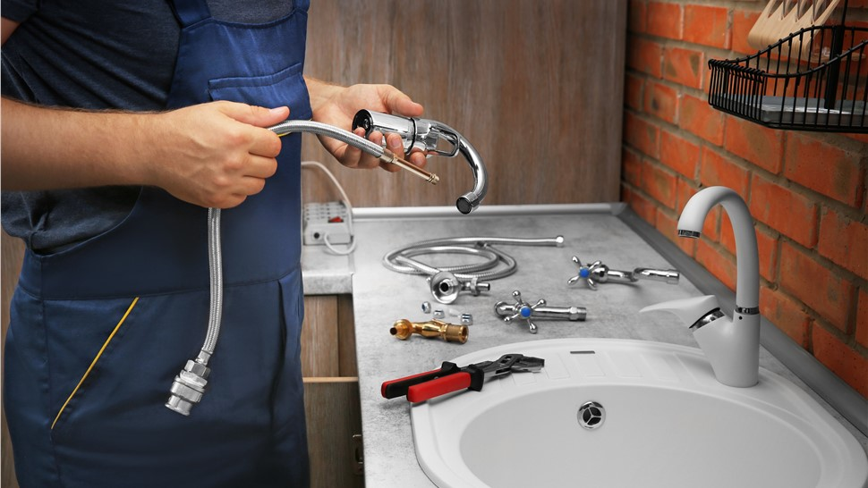 Plumbing - Toilet and Faucet Replacement Photo 1