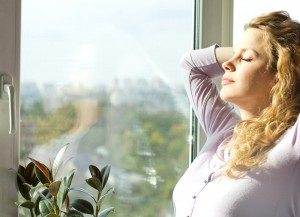 woman breathing clean air in home