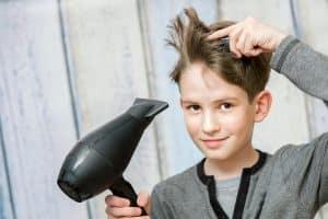 boy blow drying his hair