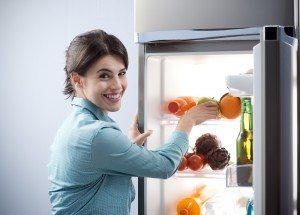 women opening refrigerator