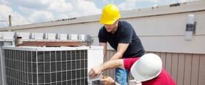 men installing air conditioner