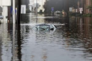 car sunk in deep flood waters