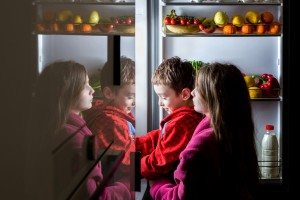 kids looking into the fridge