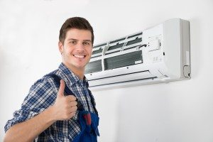 air conditioner repairman giving thumbs up