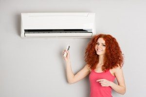 happy woman and air conditioner