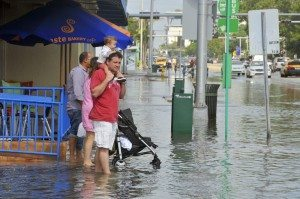 man standing in flood in miami