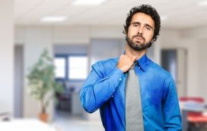 man in dress shirt covered in sweat