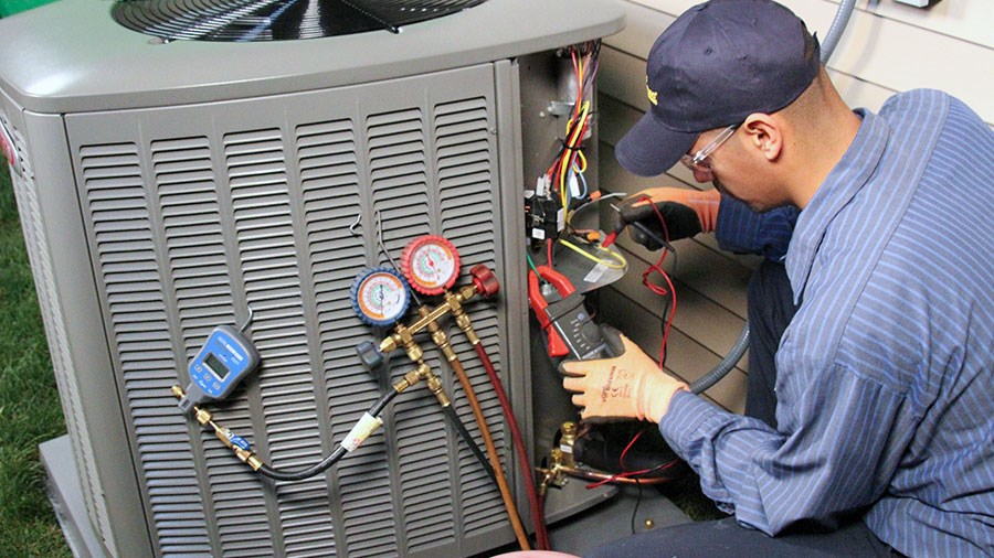 Technician Repairing AC