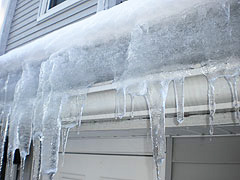 Ice Dams form a wall of ice at the lowest point on the roof. Dams and Icicles form from lack of good ventilation and insulation.