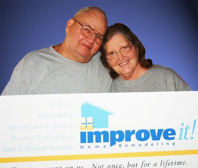 Jimmie and Janet Moore (from left) are presented with a certificate from Improve<em>it!</em> Home Remodeling for a new leaf and debris free gutter system as winners of the 2008 Grand Prize in the Home Makeover Sweepstakes. Now in its 12th year, the 2009 annual sweepstakes is available online at www.improveitusa.com. Improve<em>it!</em> is a nationally recognized home remodeling company serving the Ohio market with over 30,000 sold jobs to residential homes. A high resolution image of this photo is available to qualified news agencies upon request.