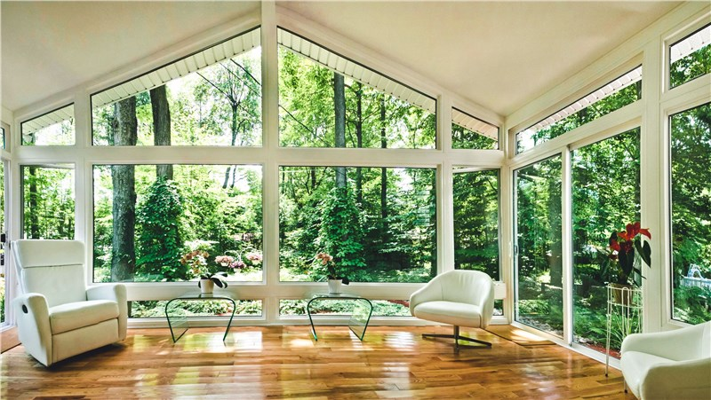 sunroom with large windows and wood floor