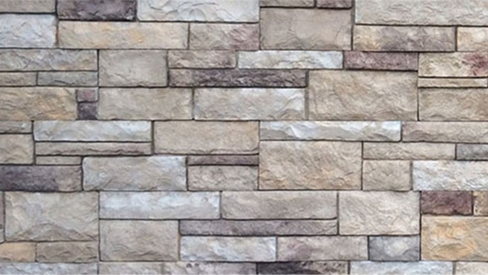 Stone veneer faux stone panels fake rock siding for Stone facade siding