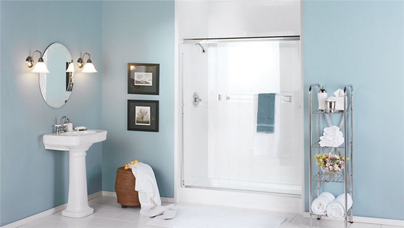 blue bathroom with shower, sink and toilet