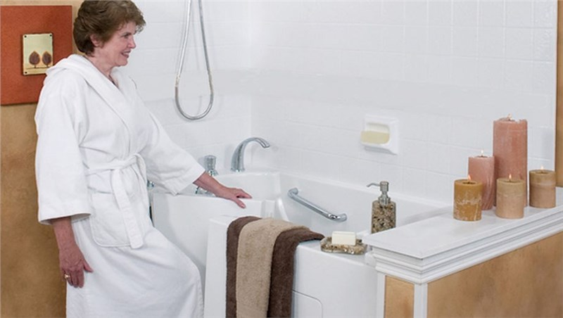 woman walking into walk-in tub by luxury bath of texoma