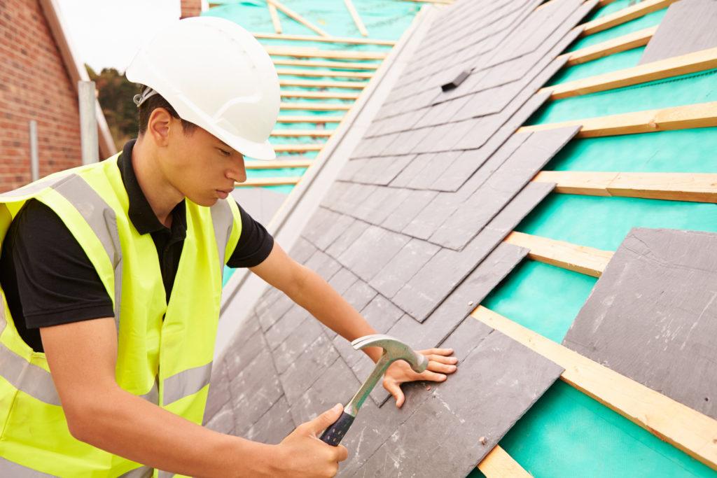 Roofer repairing roof work