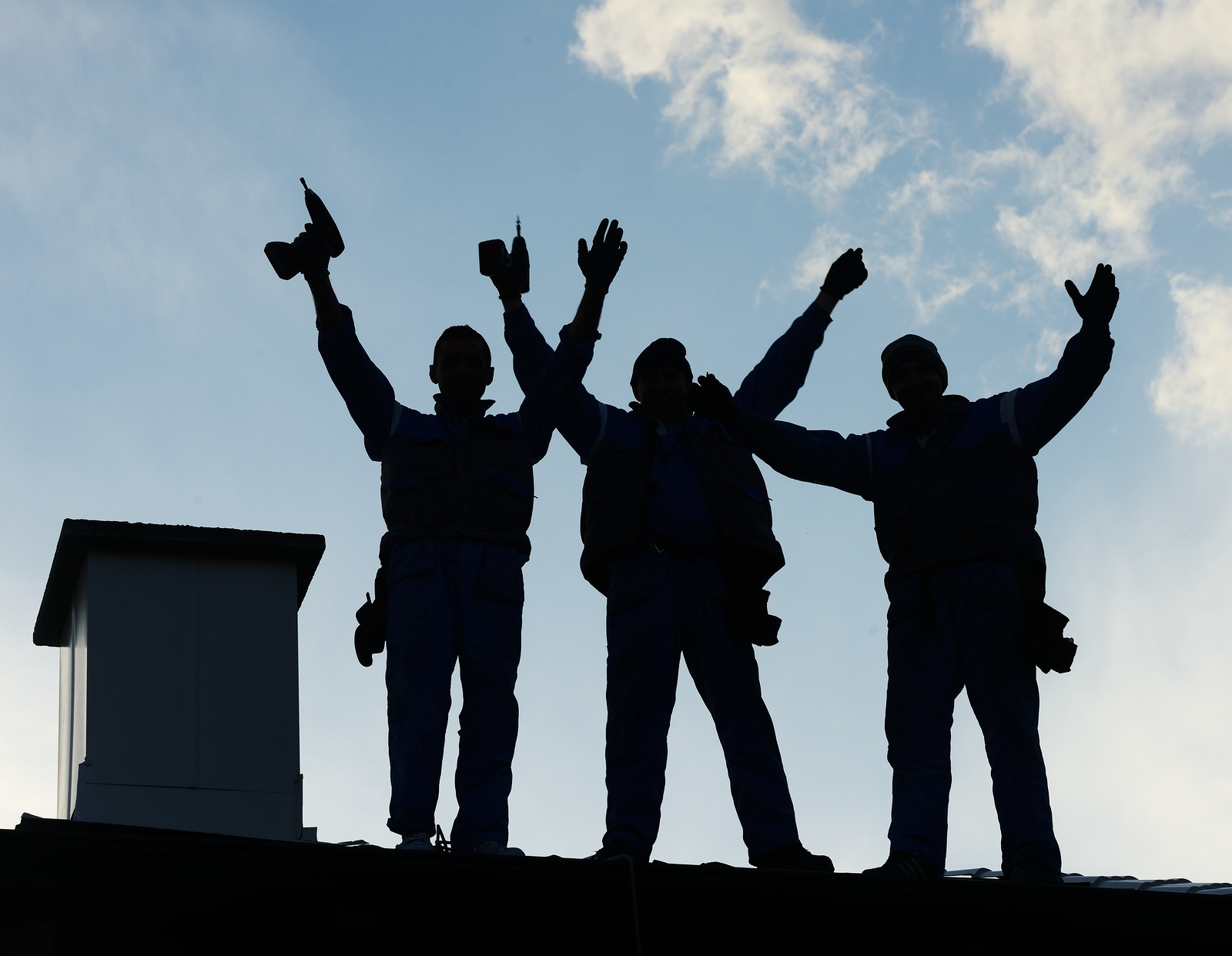 Silhouette of roofers