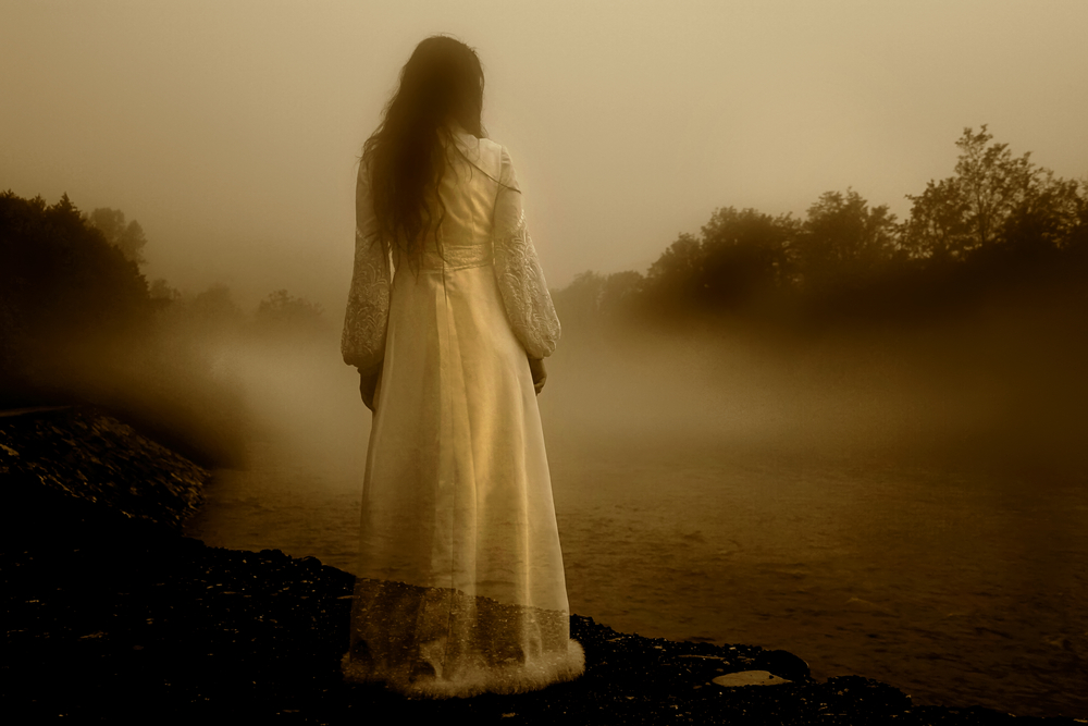 Ghost in a white dress next to a river