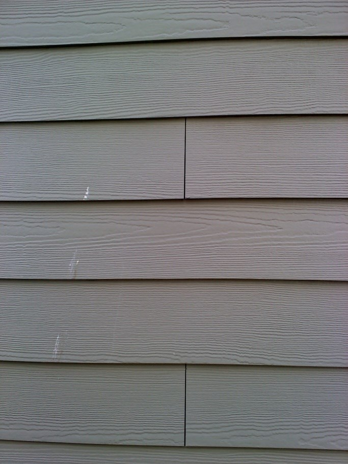 Homeowners Install Everlast Advanced Composite Siding