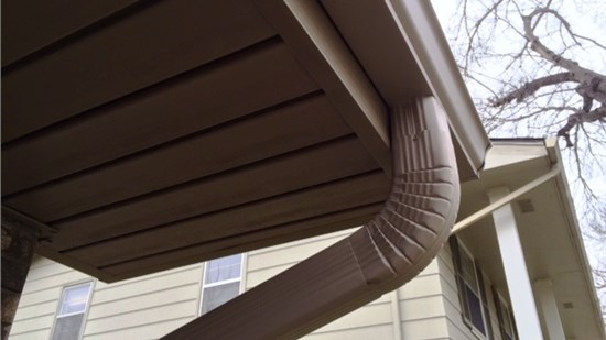 Seamless Gutters with Gutter Cap Stone Coat.