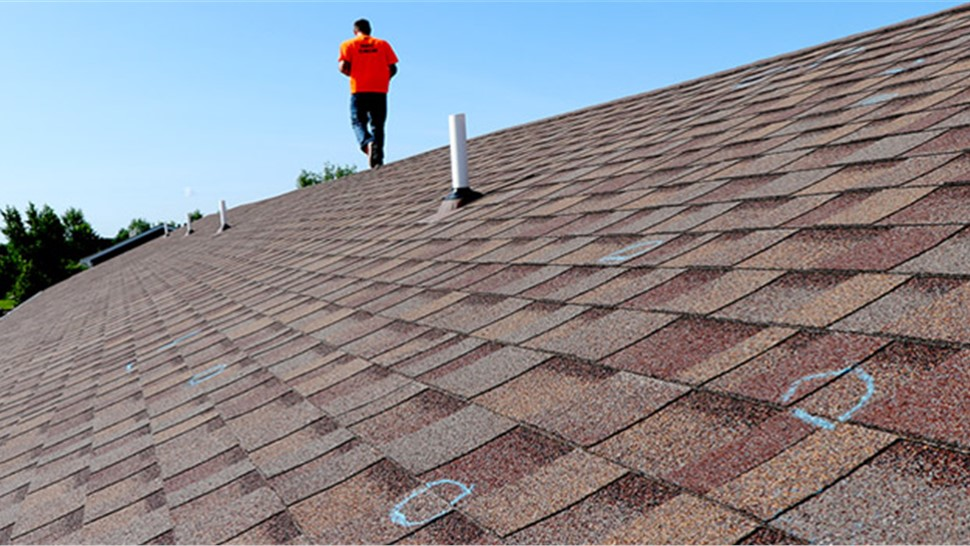 Marking Hail Damage; NMC's Expert Roof Inspection in Maple Grove