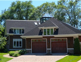 NMC Delivers Amazing Roof Results—When hail cripples your roof system with damage & leaks; Shown: Onyx Black