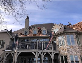 Cool progress photo of the new cedar roofing being installed in Excelsior