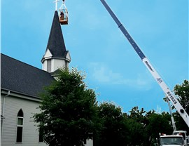 NMC Uses Boom Crane to Repair Steeple at Living Branch Lutheran Church