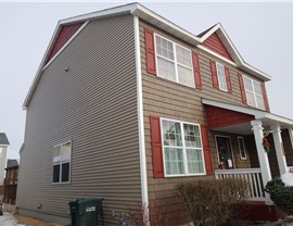 Total Exterior in Vinyl Siding by NMC; Clever color changes & shake style makes an impact