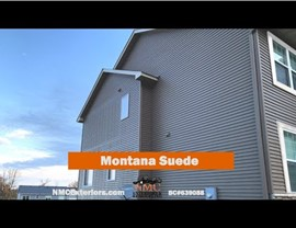 NMC installs insurance-approved new roof and siding after the Hail. Montana Suede Siding and Teak Roof.