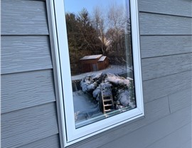 New Charcoal Gray steel siding in Bloomington during wintertime
