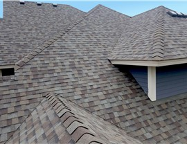 NMC replaces this Insurance Approved Medina roof in Duration Driftwood