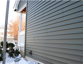 Vinyl Siding Replacement after Hail Damage in Maple Grove