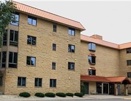 Mary Patrice Apartments in Osseo, Minnesota updated their roof using Copper Standard Seam Panels
