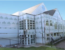 NMC is installing new siding on The Grove Church! Steel Timbergrain siding by Edco in Glacier White