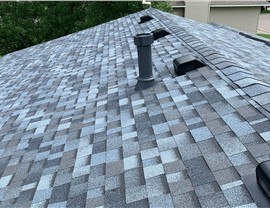 Roof Replacement after the hail in Lakeville; Shown: Designer Pacific Wave