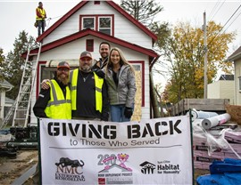 NMC, Owens Corning, and Habit of Humanity donate a full roof replacement
