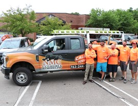 Field Supervisor team standing in front of the work truck in front of the office.