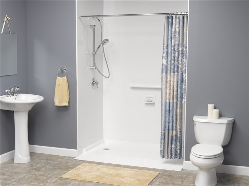 bathroom featuring barrier free roll-in shower